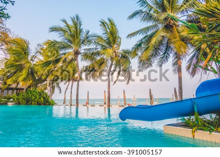 Beautiful luxury umbrella beach and chair around swimming in hotel resort - Boost up color Processing