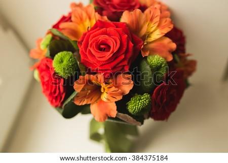 Beautiful luxury wedding bouquet of red flowers - stock photo