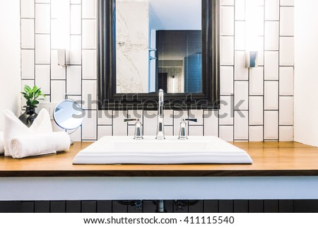 Beautiful luxury white sink decoration in bathroom interior - Vintage Light Filter - stock photo
