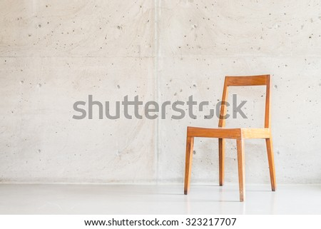 Beautiful luxury wooden chair decoration on empty wall with vase plant