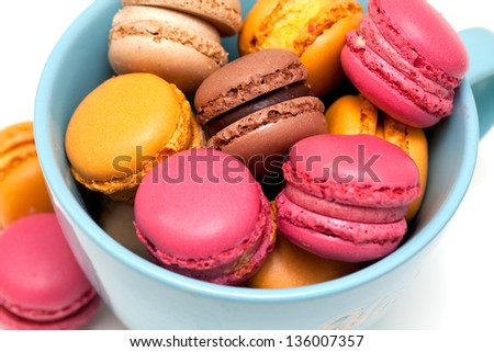 beautiful macarons in a blue cup