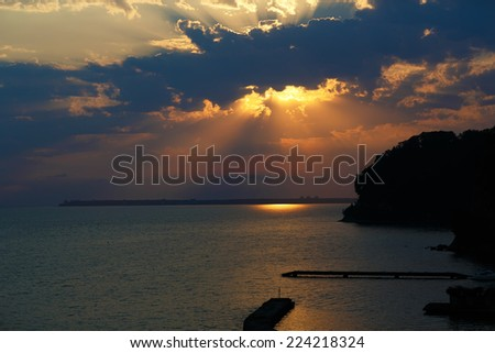 Beautiful magic sunset at The Black sea, Abkhazia, on a warm summer evening - stock photo