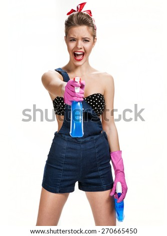Beautiful maid wearing pink rubber protective gloves holding blue cleaning spray bottles / young beautiful American pin-up girl isolated on white background. Cleaning service concept - stock photo