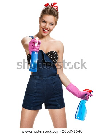 Beautiful maid wearing pink rubber protective gloves holding cleaning spray bottles / young beautiful American pin-up girl isolated on white background. Cleaning service concept - stock photo