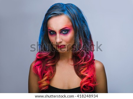 Beautiful make up, hard colors red and blue , studio