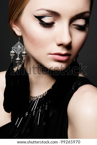 beautiful make up portrait over black background - stock photo