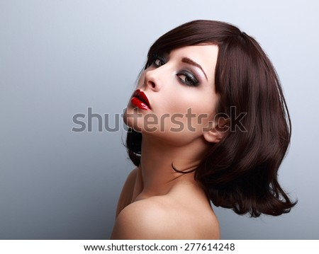 Beautiful makeup profile of black hair style woman on blue background - stock photo