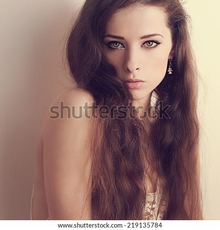 Beautiful makeup woman looking passion. Closeup light art portrait - stock photo