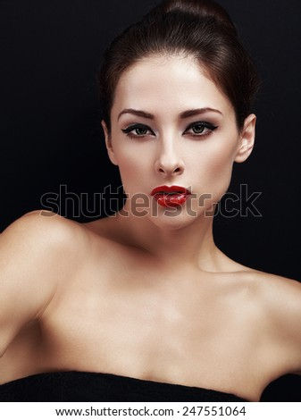 Beautiful makeup woman with red lipstick. Closeup on black background - stock photo