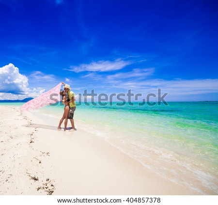 Beautiful man and sexy woman, has tan sport body, bikini and  hat. Tropical blue sun sea in Philippines. Luxury holiday resort. Island atoll about coral reef. Fresh freedom. Adventure day - stock photo