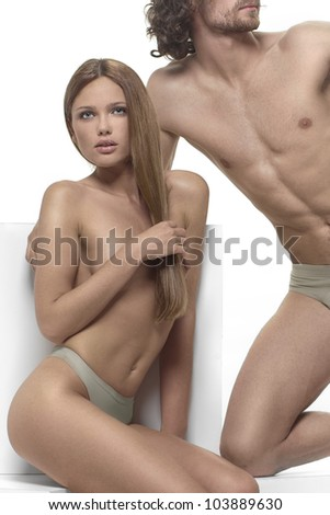 beautiful man and woman Adam and Eve, posing on a white background