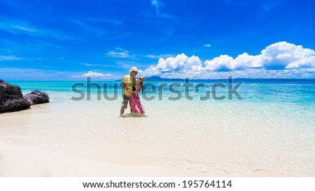 beautiful man and woman  at the sea on the Philippine island