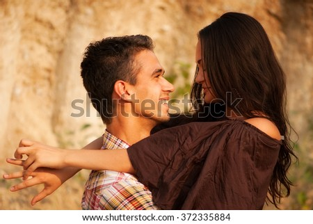 Beautiful man and woman embracing in nature. portrait - stock photo