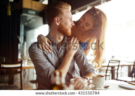 Beautiful man and woman flirt in cafe - stock photo