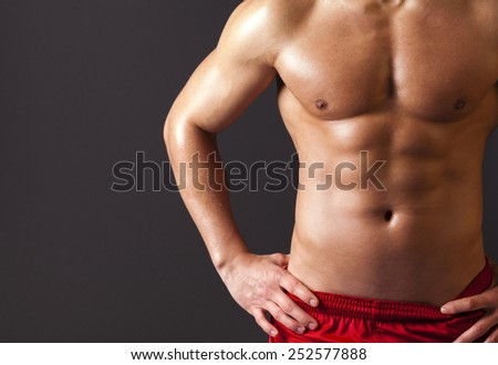 Beautiful man torso on grey background