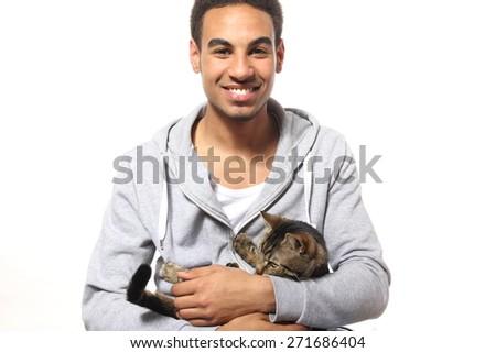 Beautiful man with cat - stock photo