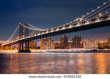 Beautiful Manhattan Bridge from Brooklyn to New York City lit up at night - stock photo