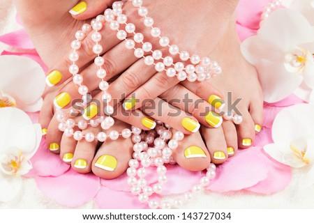 beautiful manicure and pedicure - stock photo