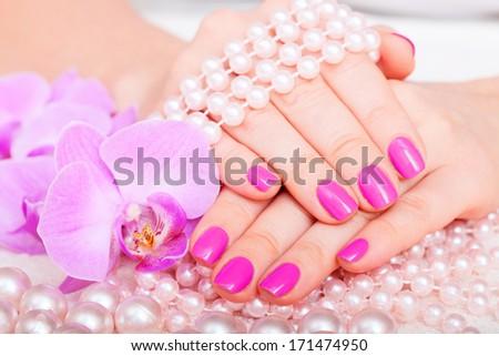 Beautiful Manicure and Pedicure in spa salon. - stock photo