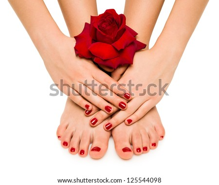 Beautiful manicure and pedicure with a rose - stock photo