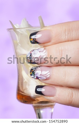 Beautiful manicure with flowers - stock photo