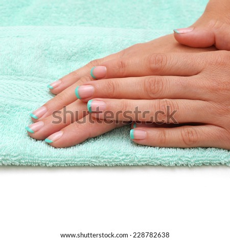 Beautiful manicured woman's nails - stock photo