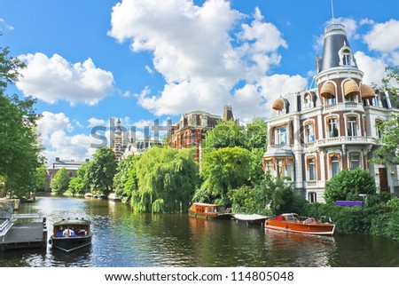 Beautiful mansion on a canal in Amsterdam. Netherlands - stock photo