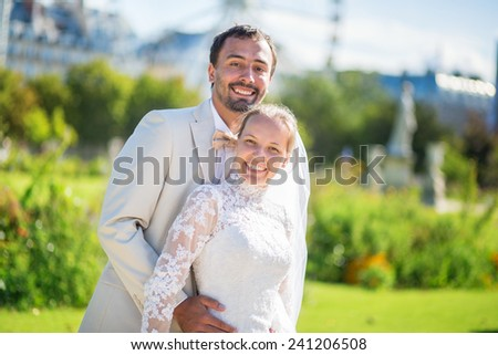 Beautiful married couple in the Tuileries garden of Paris