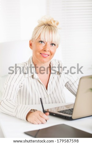 Beautiful mature Business woman at pause in the office