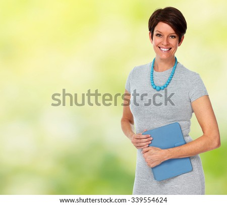 Beautiful mature business woman over green background. - stock photo