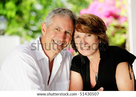 Beautiful mature couple. Shallow DoF with focus on the woman.