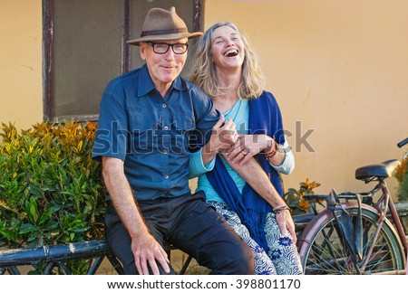 beautiful mature dutch couple outside of their house - stock photo