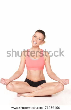Beautiful mature fitness model in yoga pose with head tilted