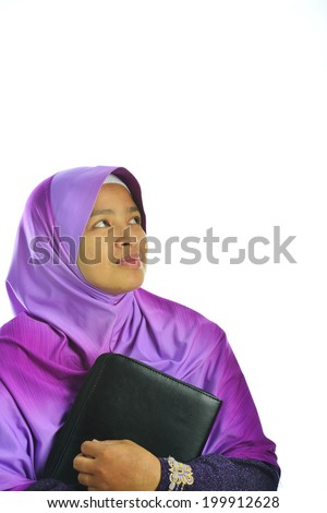 Beautiful mature Muslim woman in thinking with files and looking around