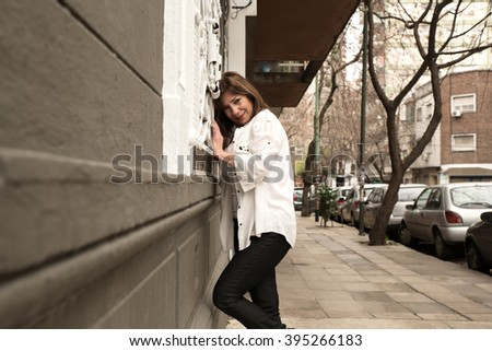 Beautiful mature woman cheerful on streets of Buenos Aires, Argentina.