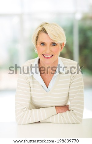 beautiful mature woman relaxing at home - stock photo