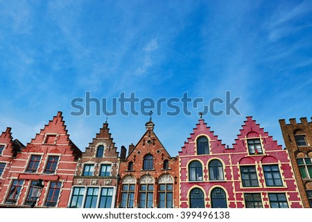 Beautiful medieval buildings on Grote Markt square in Brugge at morning, Belgium - stock photo