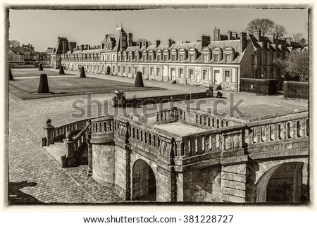 Beautiful Medieval landmark - royal hunting castle Fontainbleau. Palace of Fontainebleau - one of largest royal chateaux in France (55 km from Paris), UNESCO World Heritage Site. Vintage photo.