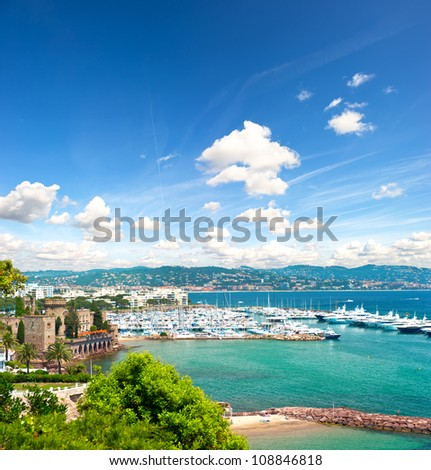 beautiful mediterranean landscape with cloudy blue sky. view of sea and luxury resort of Cote d'Azur in France. french riviera - stock photo