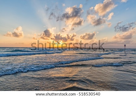 Beautiful Mediterranean sea sunset at the beach in Tel Aviv Israel.