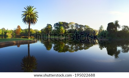 beautiful melbourne garden on a sunny autumn day - stock photo