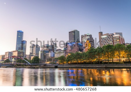 Beautiful Melbourne sunset skyline with Yarra river reflections.