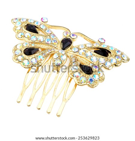 beautiful metallic hairpin on a white background
