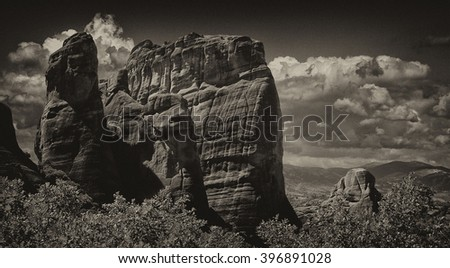 Beautiful Meteora cliffs, Greece on black and white - stock photo