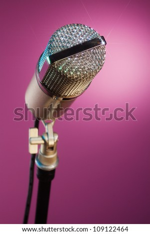 beautiful microphone on pink background