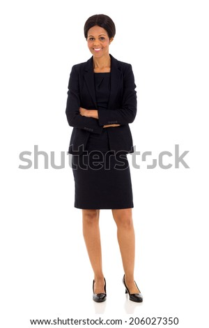 beautiful mid age african businesswoman with arms crossed - stock photo