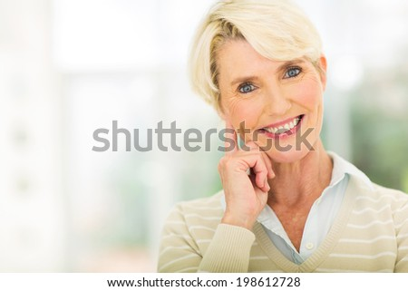 beautiful mid age lady looking at the camera - stock photo