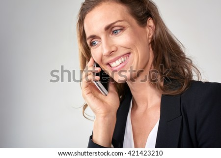Beautiful middle age business woman talking smiling on mobile cell phone smartphone - stock photo