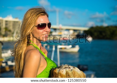 Beautiful middle age woman outdoor portrait in a water setting in the late afternoon.