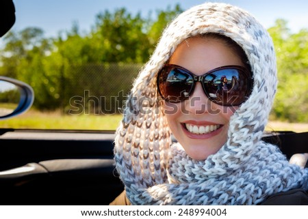 Beautiful middle age woman outdoor portrait in automobile. - stock photo